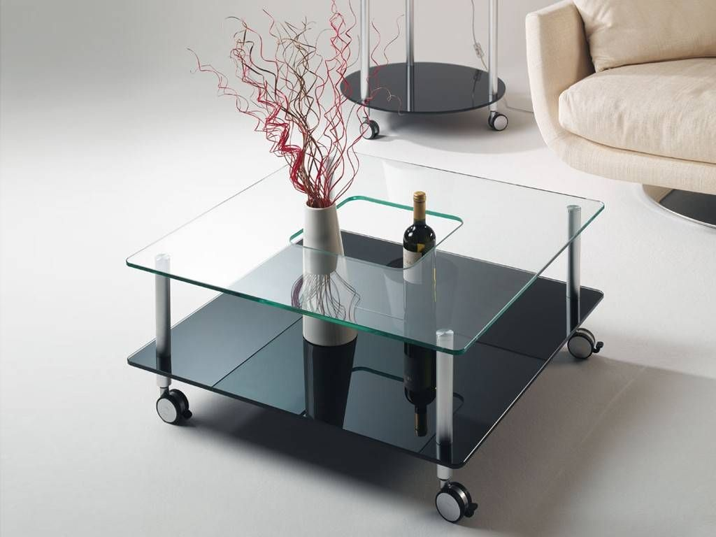 Hole glass coffee table with wheels for Coffee tables on wheels