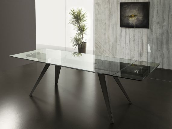 Extendible table in glass with legs in metal Track