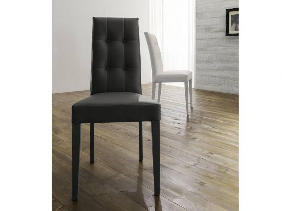 Still chair in solid beech wood and leatherette