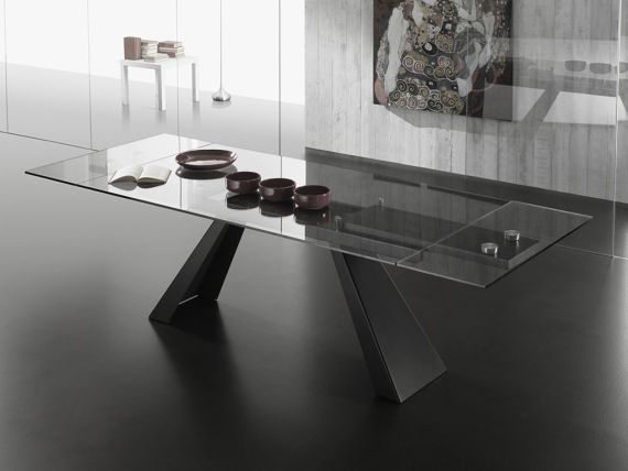 Extendible table in glass with legs in metal Beside