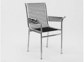 René Herbst armchair with metal structure with arms and elastic strings